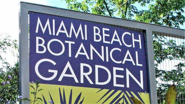 Sign Miami Beach Botanical Garden with blue sky