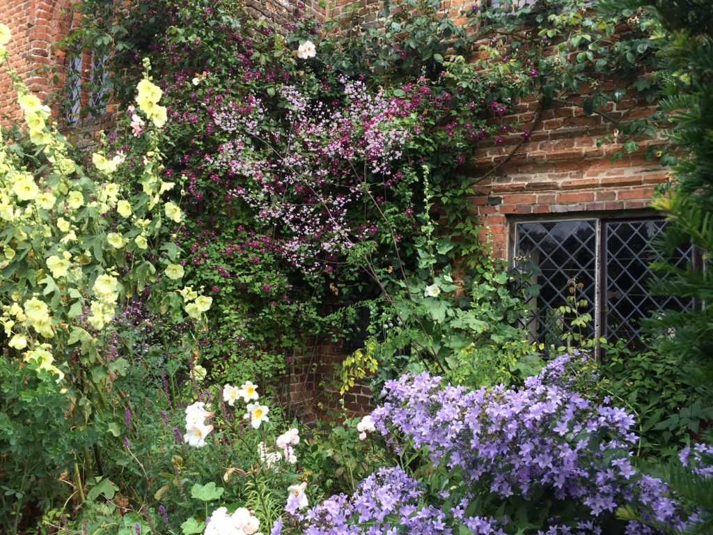 Brickstone house at Sissinghurst covered with flowers at Sissinghurst Caslte Garden,